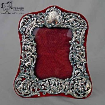 sterling silver picture frame on a velvet backing by dominick and haff